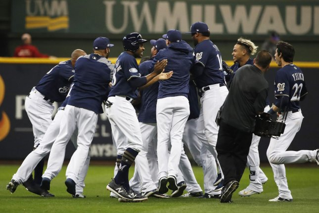The Milwaukee Brewers celebrate Mike Moustakas' game-winning walk-off single that beat the Colorado Rockies in Game 1 of the NLDS Thursday night at Miller Park in Milwaukee, Wis. Photo by Kamil Krzaczynski/UPI