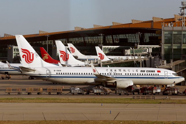 Air China airliners are parked at gates at the international airport in Beijing on July 8, 2019. The U.S. Department of Transportation threatened to ban Chinese carriers' U.S. operations unless Beijing loosens its restrictions on American carriers. File photo By Stephen Shaver/UPI