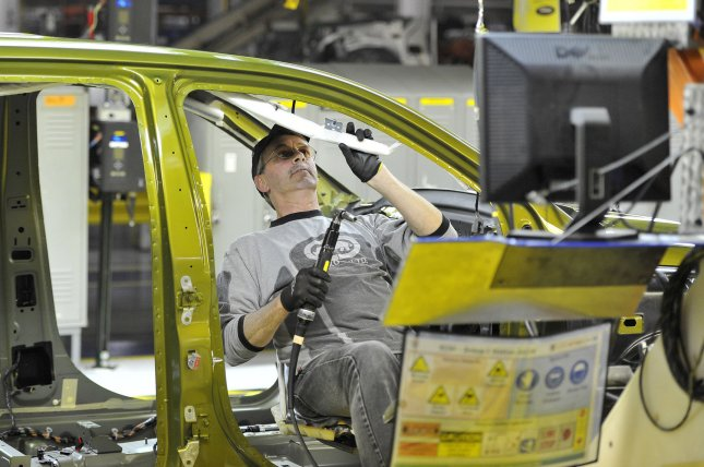 A worker assembles a vehicle at Fiat Chrysler's assembly plant in Belvidere, Ill. FCA said it will resume pre-pandemic levels of production at the Belvidere plant on Monday. File Photo by Brian Kersey/UPI