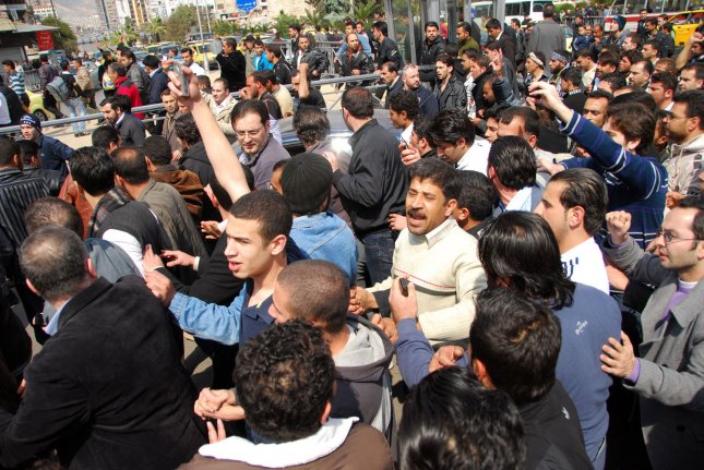 Syrian anti-government protesters shout slogans during a demonstration at Souk Al-Hamadiyeh street on Friday, March 25, 2011, after Friday prayers at Omayyed mosque in the center of Damascus Old City in Syria. Hundreds of Syrians protesters chanted slogans calling for the ouster of Syrian President Bashar al-Assad. UPI/Ali Bitar
