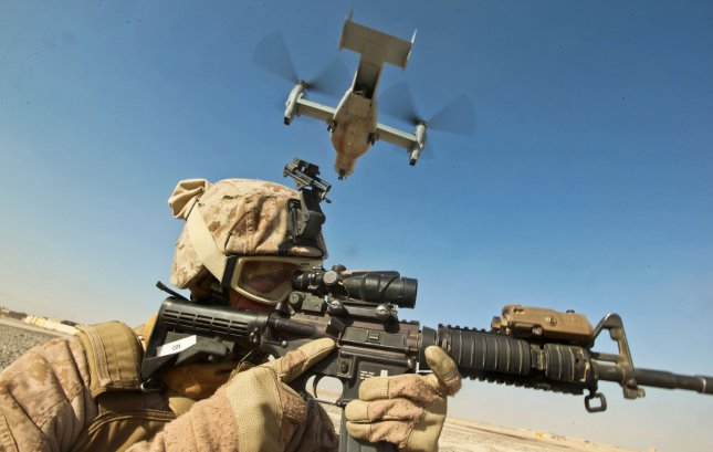 Cpl. William Cox, an armorer at the Joint Sustainment Academy Southwest, and a native of Amory, Miss., provides security as an MV-22 Osprey lands in Zaranj, Nimroz province, Afghanistan on December 30, 2011. UPI/Bryan Nygaard/Marines
