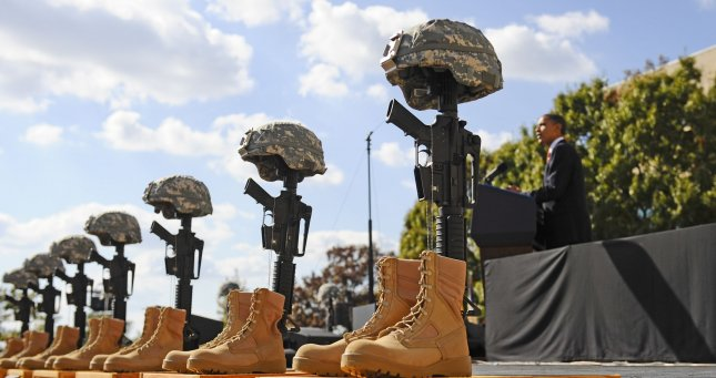 U.S. President Barack Obama spoke at the memorial service for the 12 soldiers and one civilian killed at Fort Hood U.S Army Post near Killeen, Texas, November 10, 2009. Army Major Malik Nadal Hasan faces a court-martial in the rampage on November 5 at the base's Soldier Readiness Center where deploying and returning soldiers undergo medical screenings. UPI/Tannen Maury/Pool