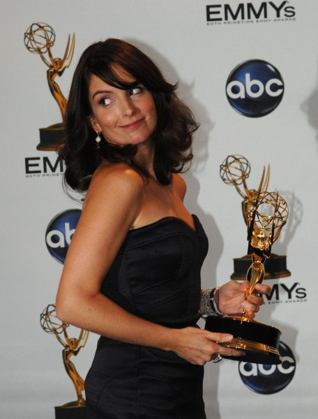 Tina Fey appears backstage with one of the three Emmy Awards she received for her work with 30 Rock at the 60th Primetime Emmy Awards at the Nokia Center in Los Angeles on September 21, 2008. (UPI Photo/Scott Harms)
