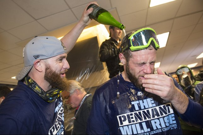 Kansas City Royals' Jonny Gomes and Greg Holland celebrate in the clubhouse after the Royals won the American Leave Championship Series after defeating the Toronto Blue Jays 4-3 in game 6 at Kaufman Stadium in Kansas City on October 23, 2015. Hosmer drove home the game winning run. Photo by Kevin Dietsch/UPI