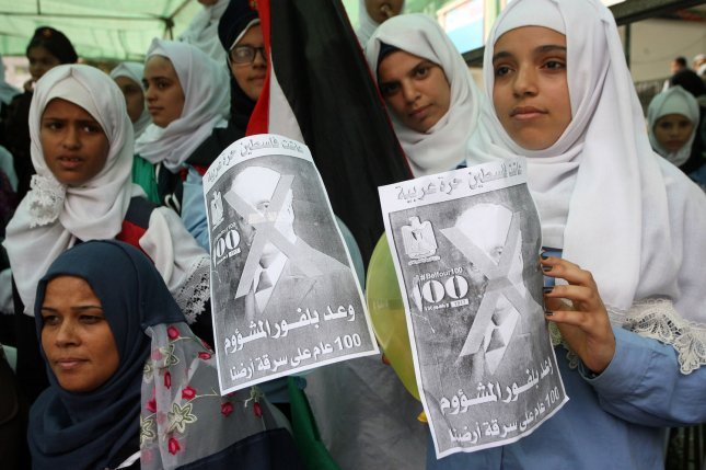 Palestinians display posters of Arthur James Balfour -- reading, in Arabic, Balfour declaration of the desperate, 100 years of stealing our land -- during a protest rally marking the 100th anniversary of Britain's Balfour Declaration in Rafah southern Gaza on Thursday. Photo by Ismael Mohamad/UPI
