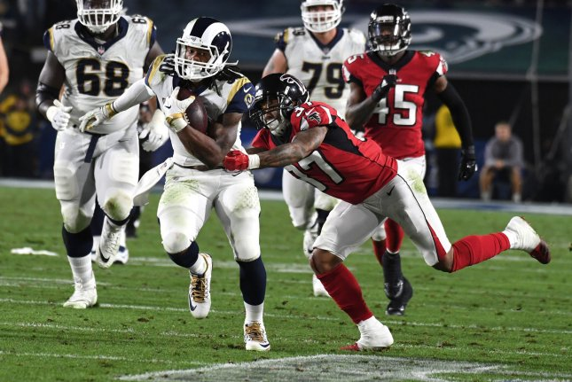 Los Angeles Rams running back Todd Gurley (L) eludes the tackle of Atlanta Falcons safety Ricardo Allen (R) during their NFC Wild Card Playoff Game on January 6, 2018 at the Los Angeles Coliseum in Los Angeles. Photo by Jon SooHoo/UPI