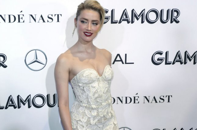 Amber Heard is bringing attention to female victims of violence as she promotes her latest movie Aquaman. Photo by Jason Szenes/UPI