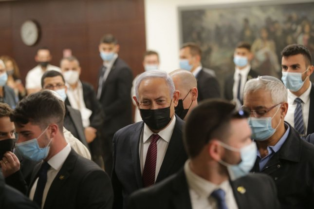 Israeli Prime Minister Benjamin Netanyahu is seen leaving the Knesset on Wednesday in Jerusalem, Israel. Payments to the PA were interrupted in June over Netanyahu's plan to annex parts of the West Bank. Photo by Alex Kolomoisky/UPI/Pool