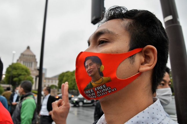 An activist with a face mask featuring the image of ousted Myanmar leader Aung San Suu Kyi is seen during a rally on May 19 in front of the Diet Building Tokyo, Japan. Photo by Keizo Mori/UPI