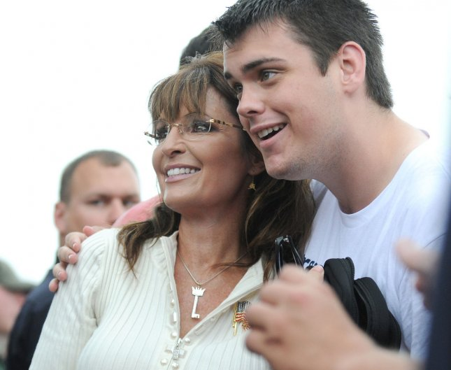 Former Alaskan Gov. Sarah Palin poses for a photo with a supporter after speaking at the Tea Party of America political rally, September 3, 2011 in Indianola, Iowa. UPI/Steve Pope