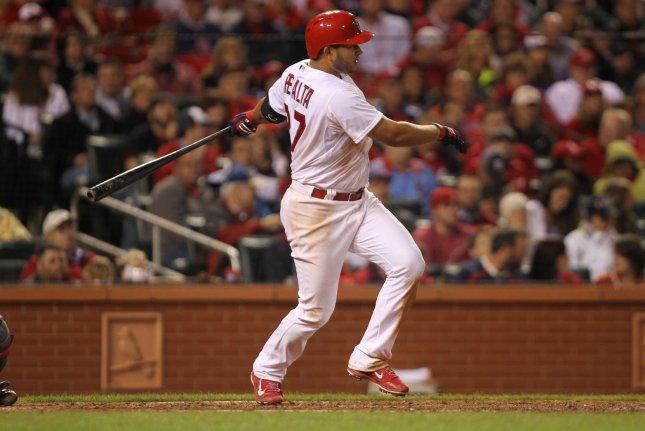 St. Louis Cardinals Jhonny Peralta swings for a single, driving in the go ahead run in the sixth inning against the Chicago Cub at Busch Stadium in St. Louis on May 13, 2014. UPI/Bill Greenblatt