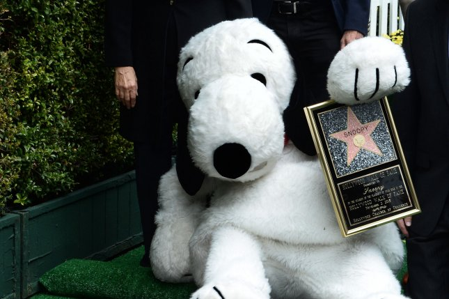Peanuts character Snoopy poses beside his star which is next to the star of his creator Charles M. Schultz after being honored with the 2,563rd star on the Hollywood Walk of Fame in Los Angeles on November 2, 2015. Photo by Jim Ruymen/UPI