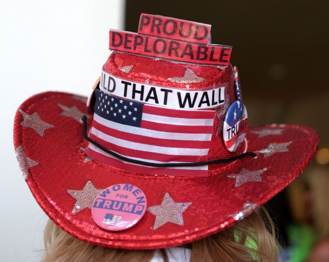 A supporter for Republican presidential nominee Donald Trump shows off her hat at a rally in Miami on September 16. Photo by Gary I Rothstein/UPI