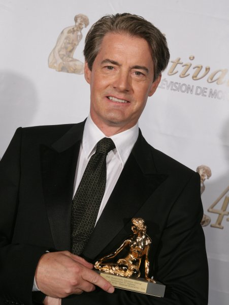 Kyle Mclachlan holds the award for Best Comedy TV Series for Desperate Parents after the closing ceremony of the 49th Monte Carlo Television Festival on June 11, 2009. The actor returns as Agent Cooper in the revival of Twin Peaks. File Photo Pool Image/UPI