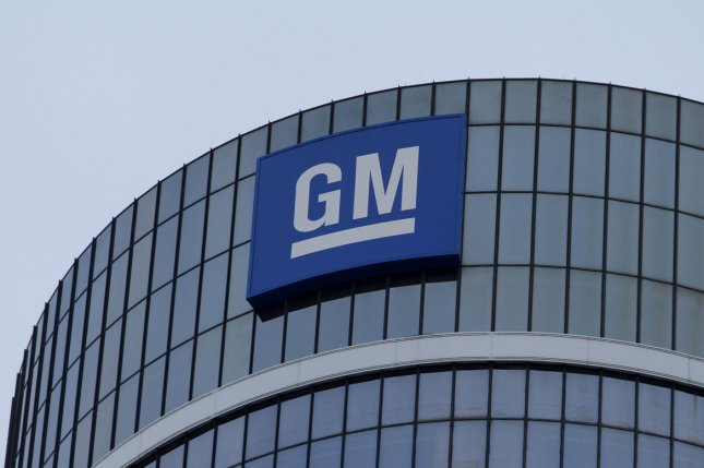 The GM logo can be seen at the top of the building at the General Motors global headquarters at the Renaissance Center on January 12, 2010 in Detroit. General Motors Venezolana said its plant in the city of Valencia as well as its assets have been seized by authorities. File Photo by Brian Kersey/UPI