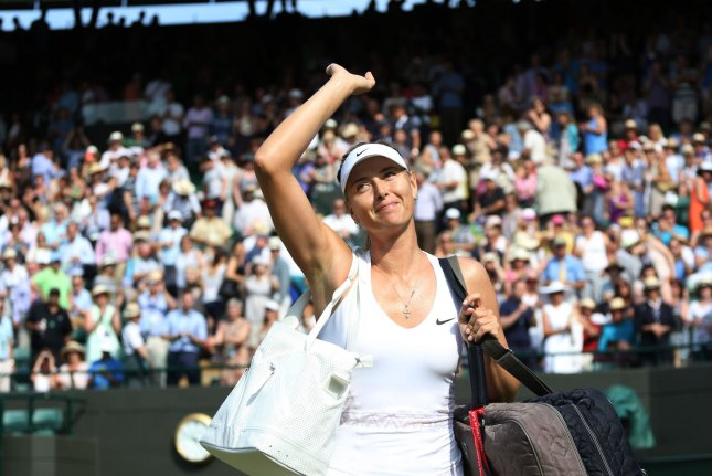 Russian Maria Sharapova waves to the crowd after her victory in her match against Irina-Camelia Begu on day five of the 2015 Wimbledon championships, London on July 3, 2015. File photo by Hugo Philpott/UPI