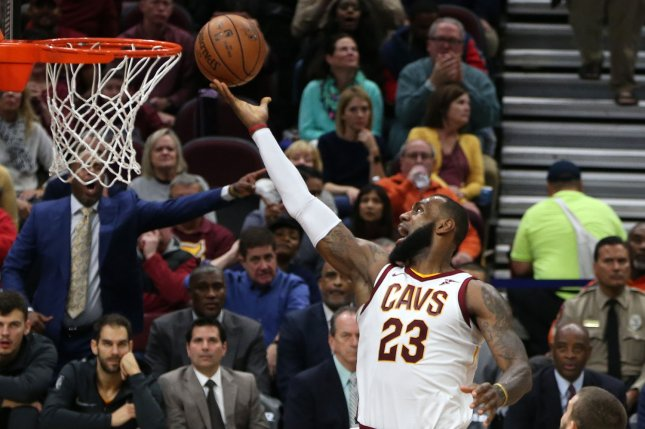 Cleveland Cavaliers' LeBron James lays the ball in for a basket past Memphis Grizzlie defender Marc Gasol during the first half at Quicken Loans Arena in Cleveland on December 2, 2017. File photo by Aaron Josefczyk/UPI