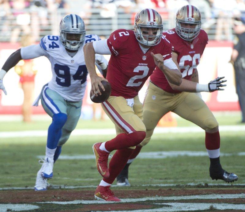Dallas Cowboys defensive end Randy Gregory (94) chases then-San Francisco 49ers quarterback Blaine Gabbert during a preseason game in 2015. Photo by Terry Schmitt/UPI