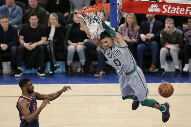 Boston Celtics forward Jayson Tatum dunks the basketball in the first half against the New York Knicks on February 24, 2018 at Madison Square Garden in New York City. Photo by John Angelillo/UPI