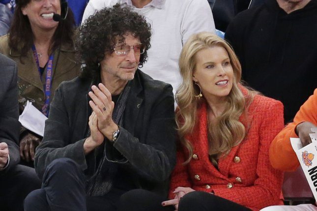 Howard Stern (L), pictured with Beth Stern, said his cancer scare made him reconsider his life and inspired his new book. File Photo by John Angelillo/UPI