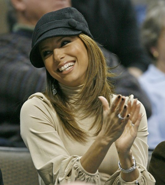 Desperate Housewives star and San Antonio Spurs guard Tony Parker's wife, Eva Longoria cheers during Spurs team introductions before the game against the Denver Nuggets during the first half at the Pepsi Center in Denver on January 3, 2008. (UPI Photo/Gary C. Caskey)