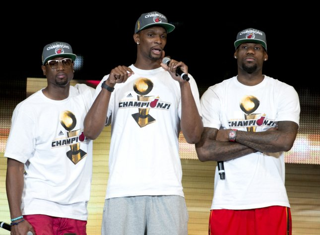 Lebron James (R), Chris Bosh (C), and Dwyne Wade take the stage during the celebration for the NBA 2012 Champions Miami Heat inside the American Airlines Arena in Miami, Florida on June 25, 2012. UPI/Gary I Rothstein