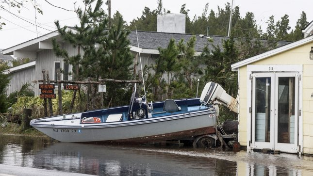 A power boat is washed up on the backyard of a house in Tuckerton, New Jersey October 30, 2012 after Hurricane Sandy made landfall late October 29, 2012. UPI/John Anderson