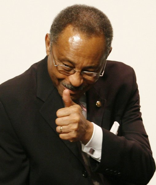 Sen. Roland Burris (D-IL) gives a thumbs-up before a prayer and support vigil held for him at the New Covenant Baptist Church in Chicago on March 1, 2009. Burris, who was appointed by embattled former Ill. Gov. Rod Blagojevich, is facing increasing calls for his resignation amid allegations of impropriety involving his appointment. (UPI Photo/Brian Kersey)
