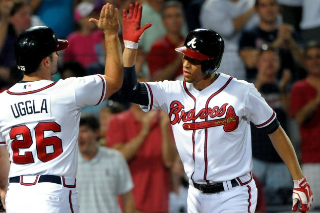 Atlanta Braves' Andrelton Simmons (R) is greeted by teammate Dan Uggla after they both score on the home run against the New York Mets by Simmons in the seventh inning at Turner Field in Atlanta, September 3, 2013. Atlanta scored three runs in the inning. UPI/David Tulis