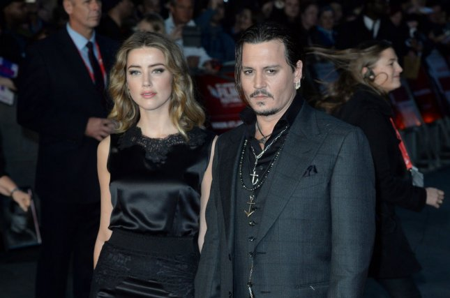 Johnny Depp (R) and wife Amber Heard at the BFI London Film Festival screening of 'Black Mass' on October 11, 2015. The actor recently pranked Heard for Velocity series 'Overhaulin'.' File photo by Paul Treadway/UPI