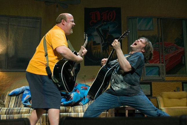 Actor and musician Jack Black (R) and bandmate Kyle Gass of Tenacious D rock the Queen Elizabeth Theater in Vancouver on February 20, 2007. File Photo by Heinz Ruckemann/UPI