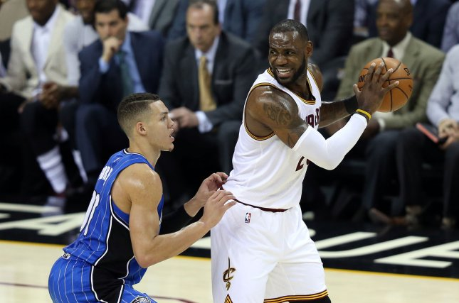 Cleveland Cavaliers LeBron James is guarded by Orlando Magics' Aaron Gordon at Quicken Loans Arena in Cleveland on April 4, 2017. File photo by Aaron Josefczyk/UPI