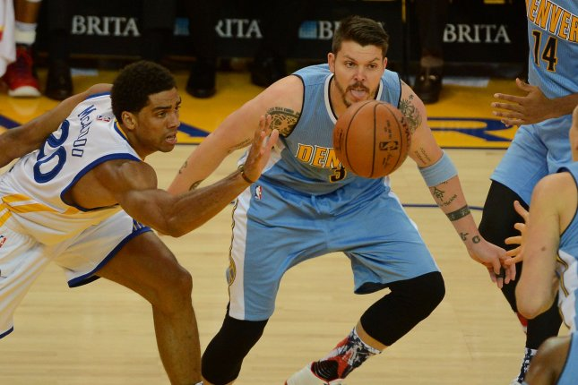 22dadc2c2697 Golden State Warriors  James Michael McAdoo (20) chases a loose ball with  Denver Nuggets  Mike Miller (3). File photo by Terry Schmitt UPI