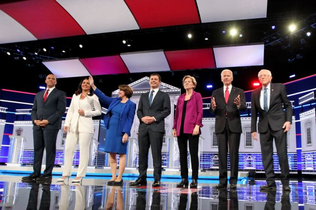 Democratic presidential candidates including, from left to right, Sen. Cory Booker, Rep. Tulsi Gabbard, Sen. Amy Klobuchar, South Bend, Ind., Mayor Pete Buttigieg, Sen. Elizabeth Warren, former Vice President Joe Biden and Sen. Bernie Sanders are introduced prior to Wednesday's debate.  Photo by Tami Chappell/UPI