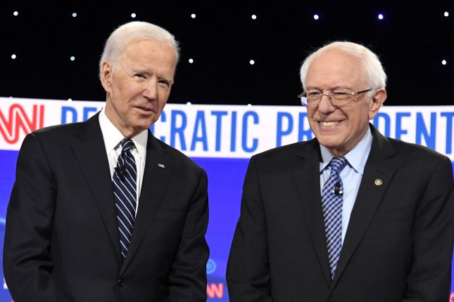 The tax plans by Biden (L) and Sanders will raise far less money than they expect and will cut into the U.S. economy, the studies said. File Photo by Mike Theiler/UPI