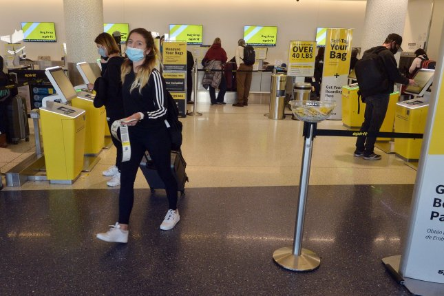 Travelers are seen at Los Angeles International Airport in Los Angeles, Calif., on November 18, 2020. It's expected that U.S. travelers will soon be able to visit the European Union for the first time in more than a year. File Photo by Jim Ruymen/UPI