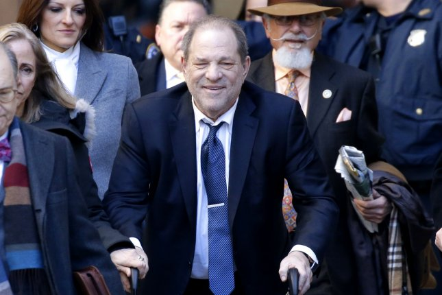 American film producer Harvey Weinstein exits Manhattan Supreme Court after deliberations in his rape trial on February 21, 2020, in New York City. He pleaded guilty Monday to separate charges in Los Angeles. File Photo by John Angelillo/UPI