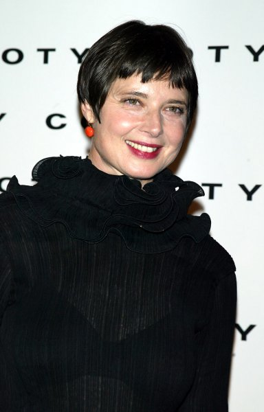 Isabella Rossellini poses for pictures at the Coty 100th Anniversary Celebration at the American Museum of Natural History in New York on September12, 2004. (UPI Photo/Laura Cavanaugh)