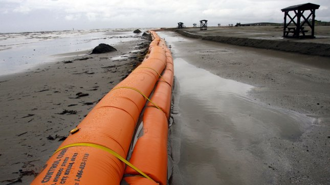 A tiger dam placed to keep oil off the beach is seen in Grand Isle, Louisiana June 30, 2010. UPI/A.J. Sisco