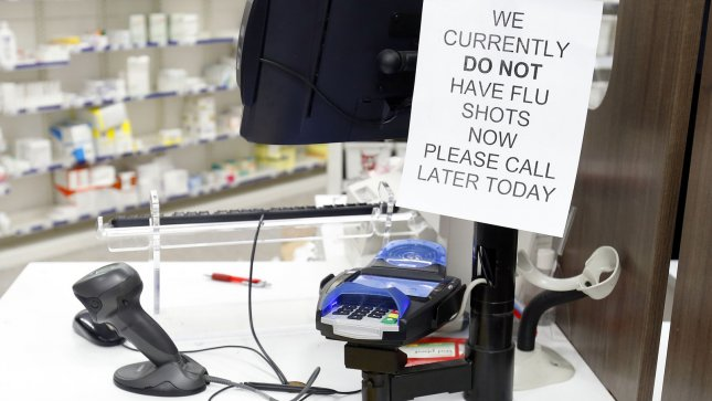 A flu vaccine out of stock sign is taped to a counter at a pharmacy in New York City on January 14, 2012. Some New York City pharmacies and clinics are reporting flu vaccine shortages prompted by reports of widespread outbreaks. UPI/John Angelillo