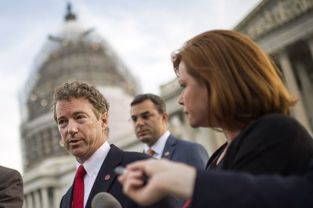 Sen. Rand Paul, R-KY, speaks to reporters after participating in a vote for the U.S.A. Freedom Act during a rare Sunday session on Capitol Hill in Washington, D.C. on May 31, 2015. Paul blocked a short-term extensions including the bulk collection of Americans' phone records, which are set to expire at midnight. The Senate voted 77-17 to take up the House-passed U.S.A. Freedom Act and will begin debate on the new government surveillance legislation. Photo by Kevin Dietsch/UPI