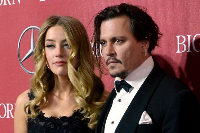 Actors Amber Heard and Johnny Depp attend the 27th annual Palm Springs International Film Festival awards gala on January 2, 2016. Heard slammed Depp over charity payments he made following their divorce settlement. File Photo by Jim Ruymen/UPI