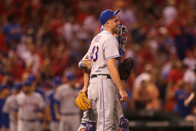 New York Mets pitcher Addison Reed and catcher Travis D'arnaud celebrate a 6-5 win over the St. Louis Cardinals at Busch Stadum in St. Louis on July 7, 2017. Photo by Bill Greenblatt/UPI