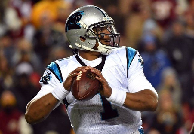 Carolina Panthers quarterback Cam Newton fades back to pass in a game against the Washington Redskins last season. Photo by Kevin Dietsch/UPI
