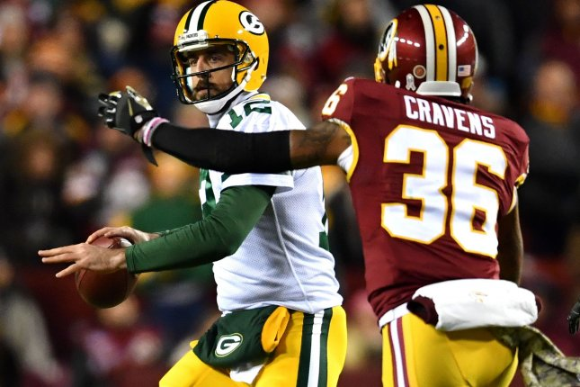 Green Bay Packers quarterback Aaron Rodgers (12) passes against Washington Redskins inside linebacker Su'a Cravens (36) at FedEx Field in Landover, Md. File photo/UPI
