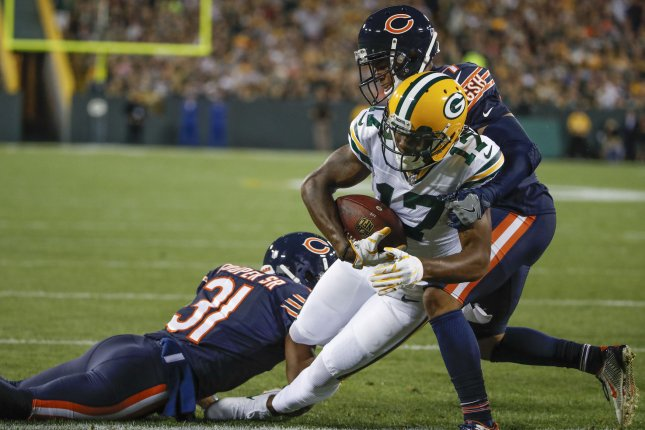 Green Bay Packers wide receiver Davante Adams (17) goes for a touchdown against Chicago Bears cornerback Marcus Cooper (L) and cornerback Bryce Callahan (R) during the first half on September 28, 2017 at Lambeau Field in Green Bay. Photo by Kamil Krzaczynski/UPI