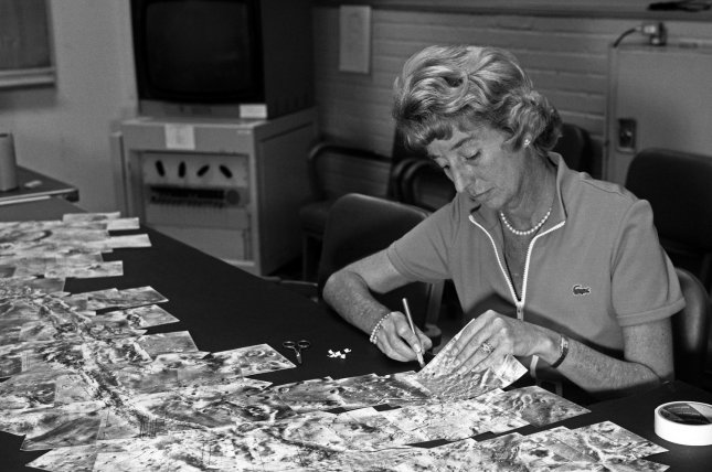 Patricia Patsy Conklin, an employee in the Bioscience and Planetology Section at NASA's Jet Propulsion Laboratory assembles Mariner 9 photos into large mosaics. On May 30, 1972, the unmanned U.S. space probe Mariner 9 was launched on a mission to gather scientific data on Mars. It was the first spacecraft to orbit a planet other than Earth. File Photo courtesy of NASA