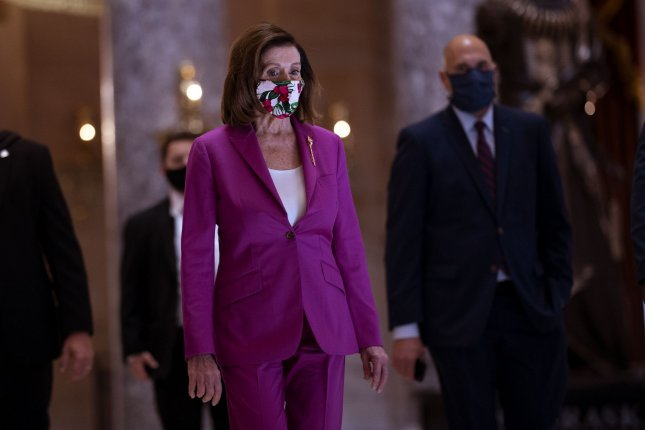Speaker of the House Nancy Pelosi, D-Calif., walks to her office Friday prior to a House vote on a new COVID-19 stimulus bill at the U.S. Capitol in Washington, D.C. Photo by Kevin Dietsch/UPI