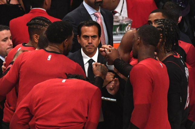 Miami Heat head coach Erik Spoelstra (C) was unable to field the league-required eight available players to move forward with Sunday's game against the Boston Celtics. File Photo by Jon SooHoo/UPI