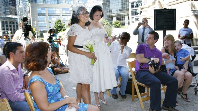Rose (L) and Jen Nagle-Yndigoyed walk down the isle during their wedding service held in Central Park on July 30, 2011 in New York City. UPI /Monika Graff